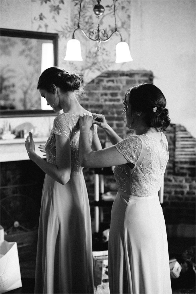 bridesmaids doing their dresses up