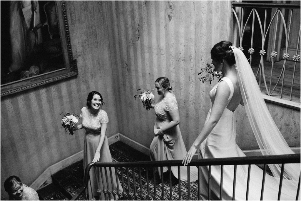 bridal party descending the stairs at St Giles House