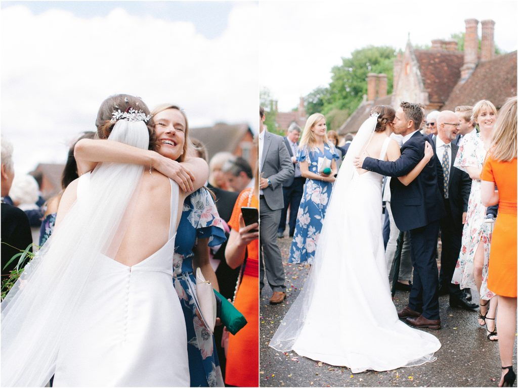 Bride being congratulated by guests after wedding