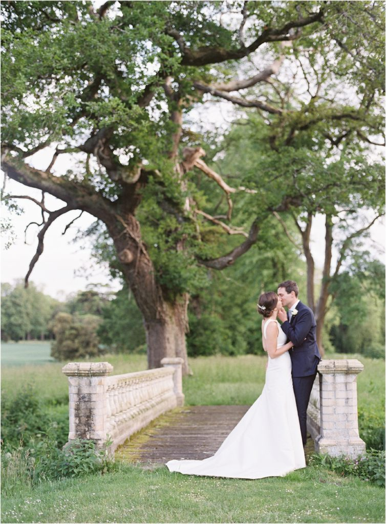 Bride and groom kissing at St Giles House wedding