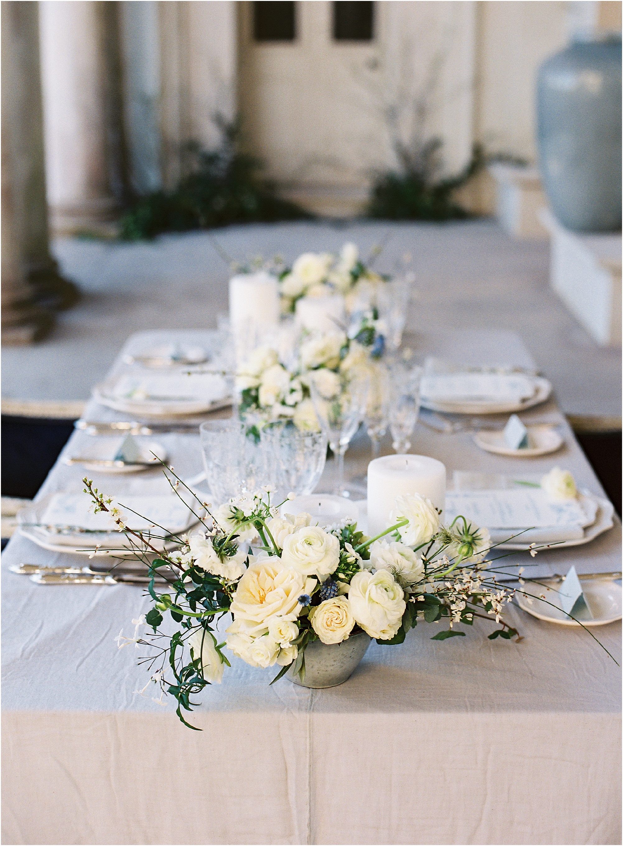 White, green and grey colour scheme for wedding breakfast table