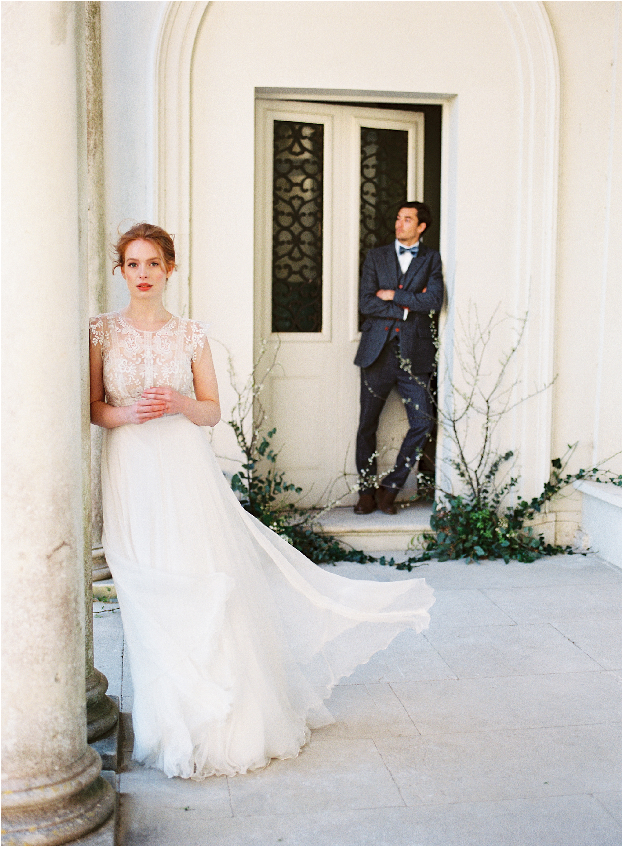 bride and groom in the porch of Somerley House wedding