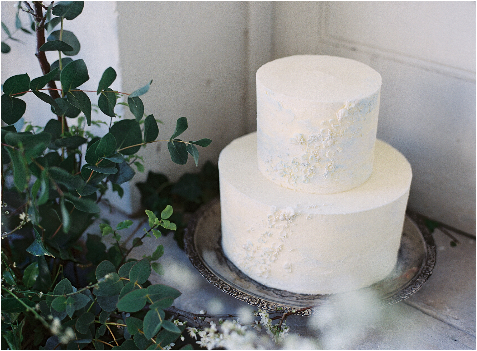 Simple and minimal white two tier wedding cake