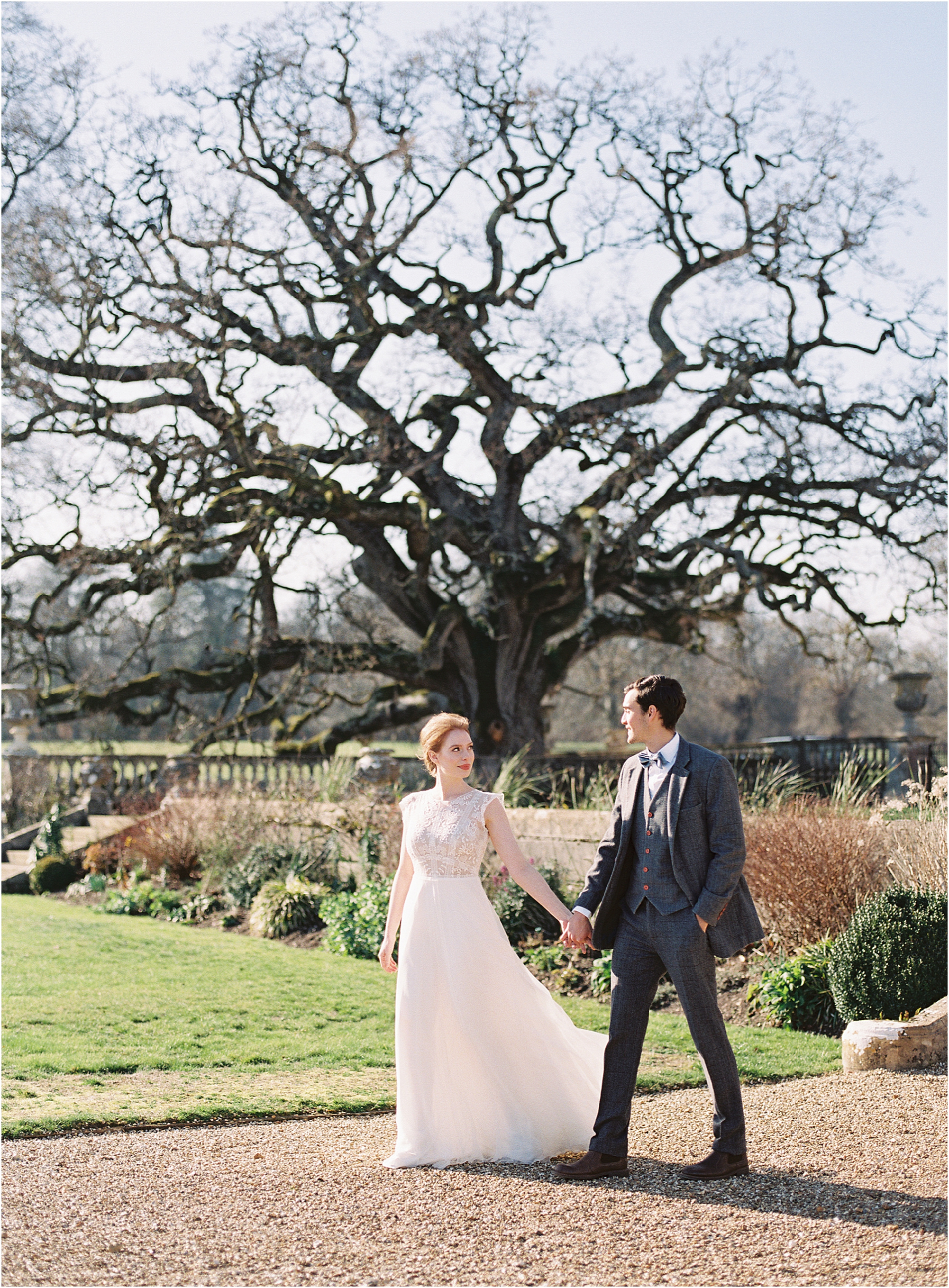 Wedding couple walking in the grounds of Somerley House