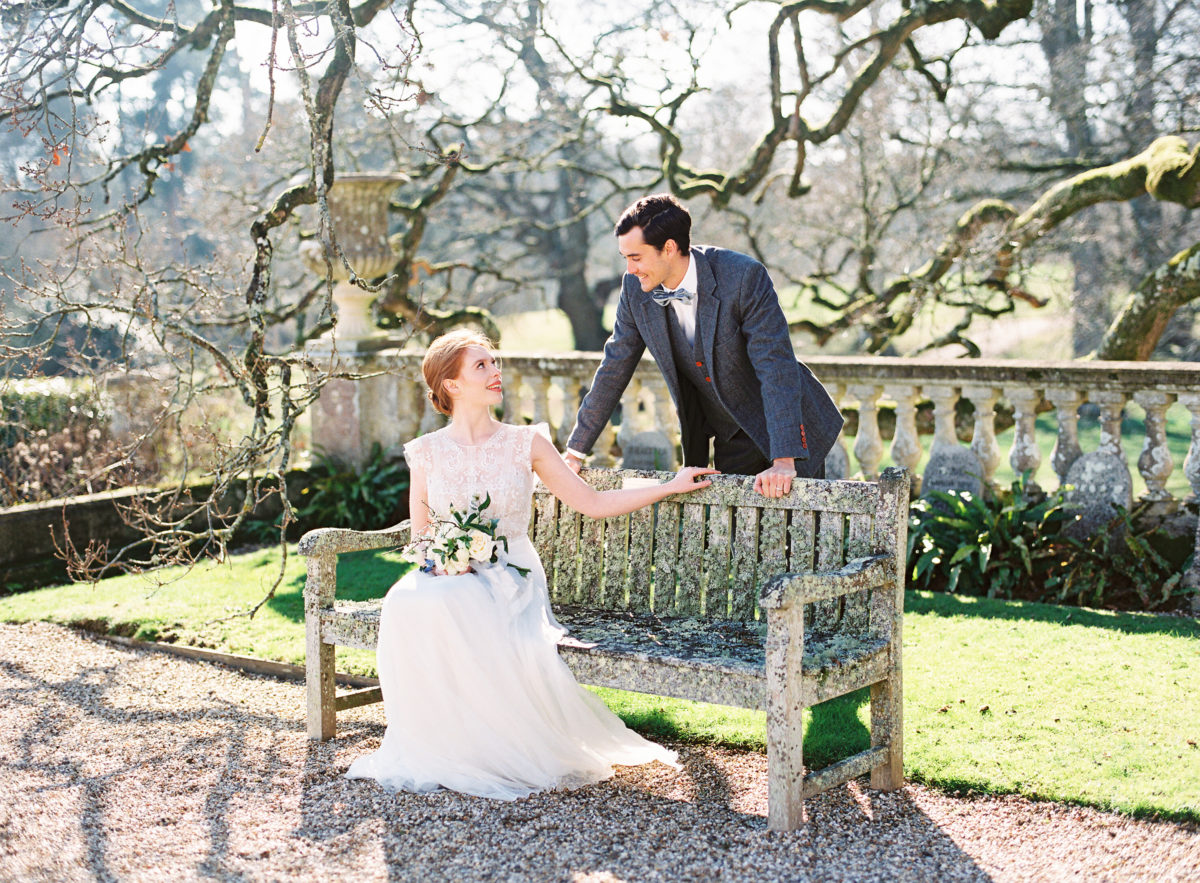 Bride and groom sitting on the bench at Somerley House