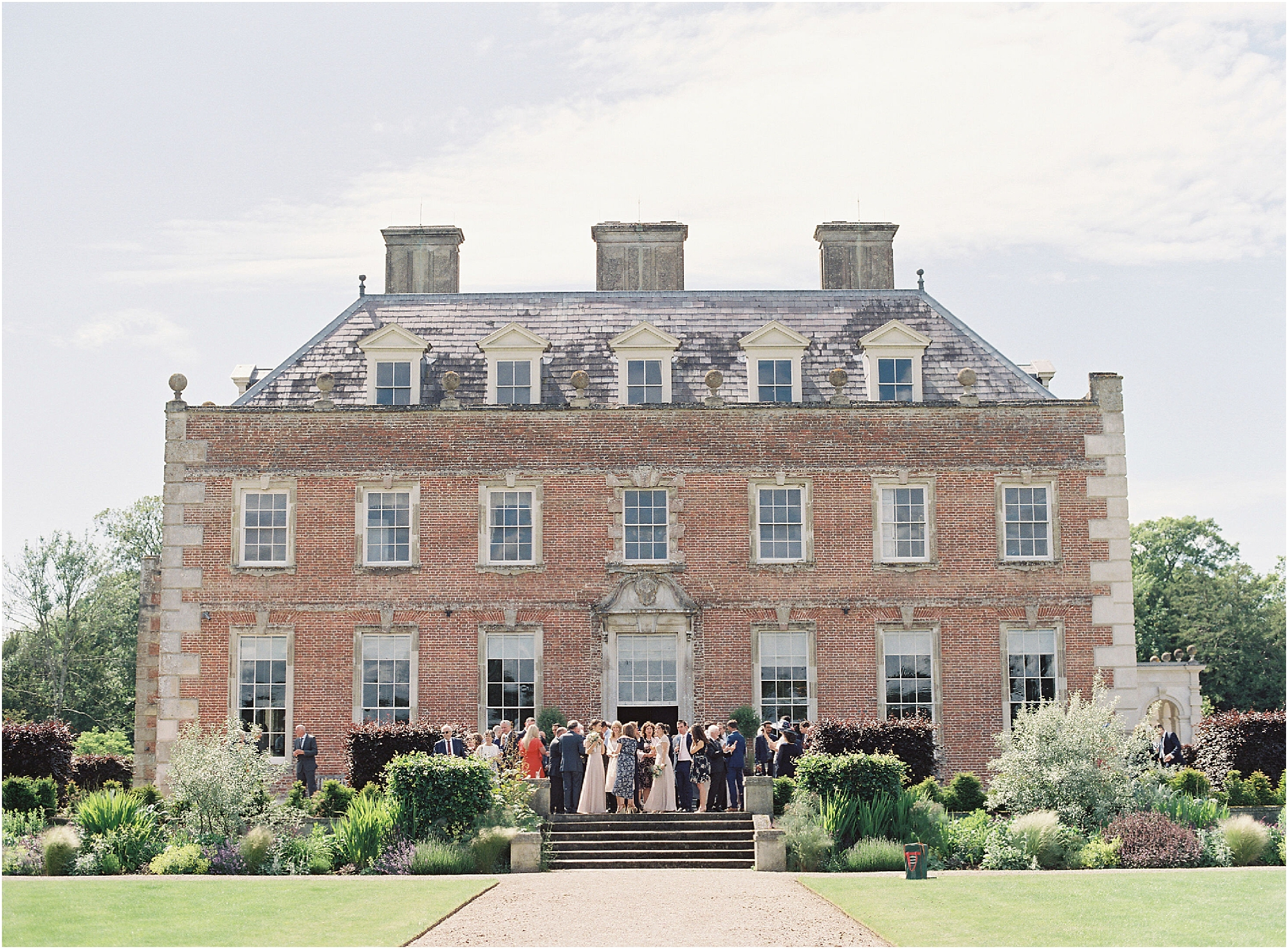 St Giles House photographed during a wedding reception by Camilla Arnhold romantic film wedding photogragraphy