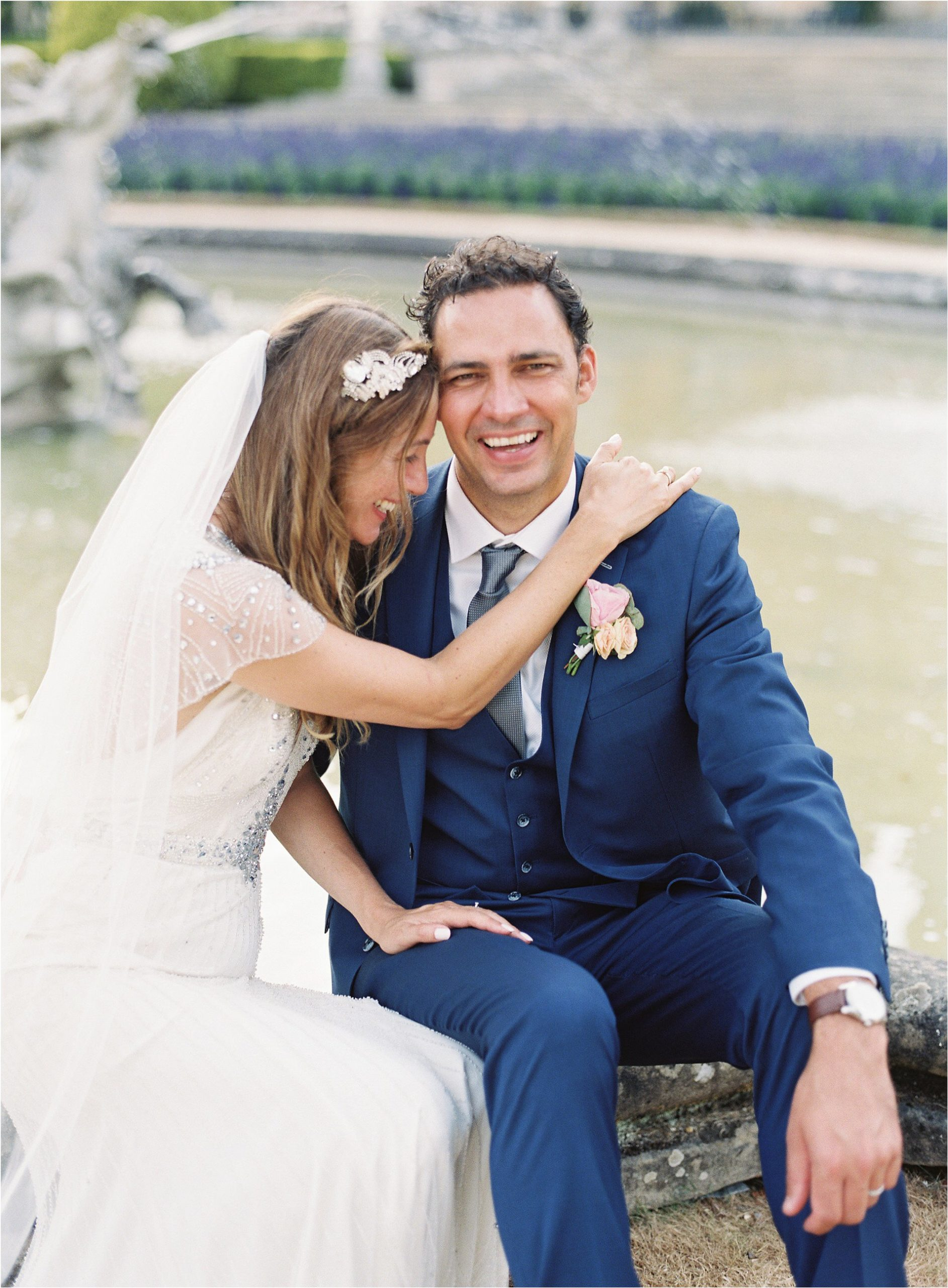 Groom laughing during romantic couple portraits