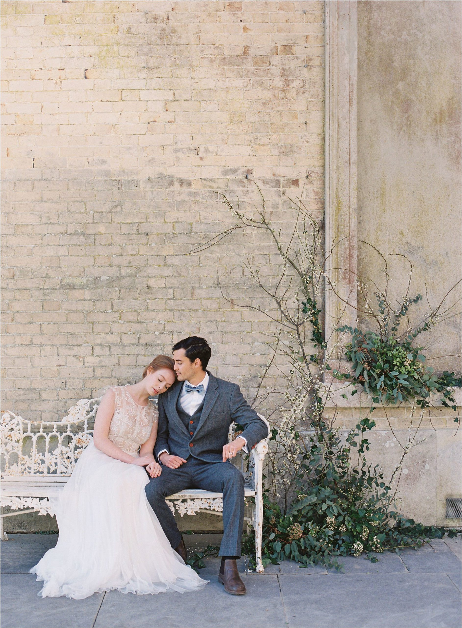 Couple cuddling on bench at Somerley House wedding venue