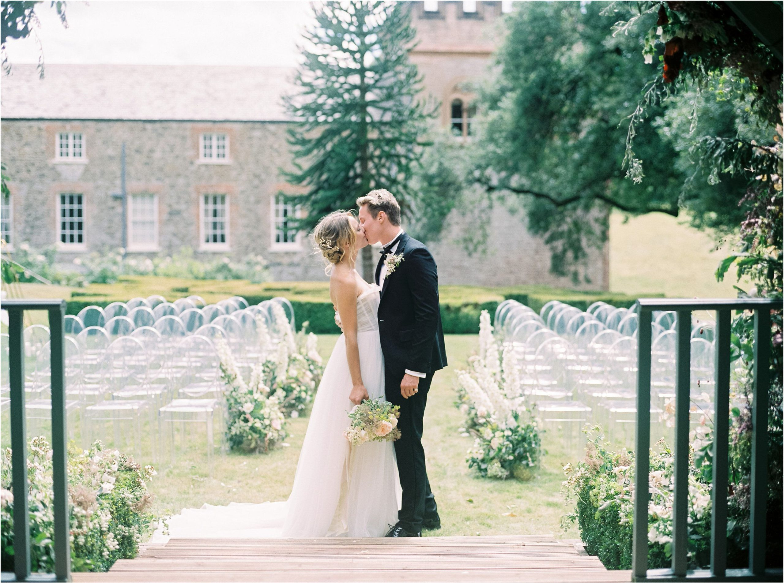 First kiss in outdoor wedding ceremony