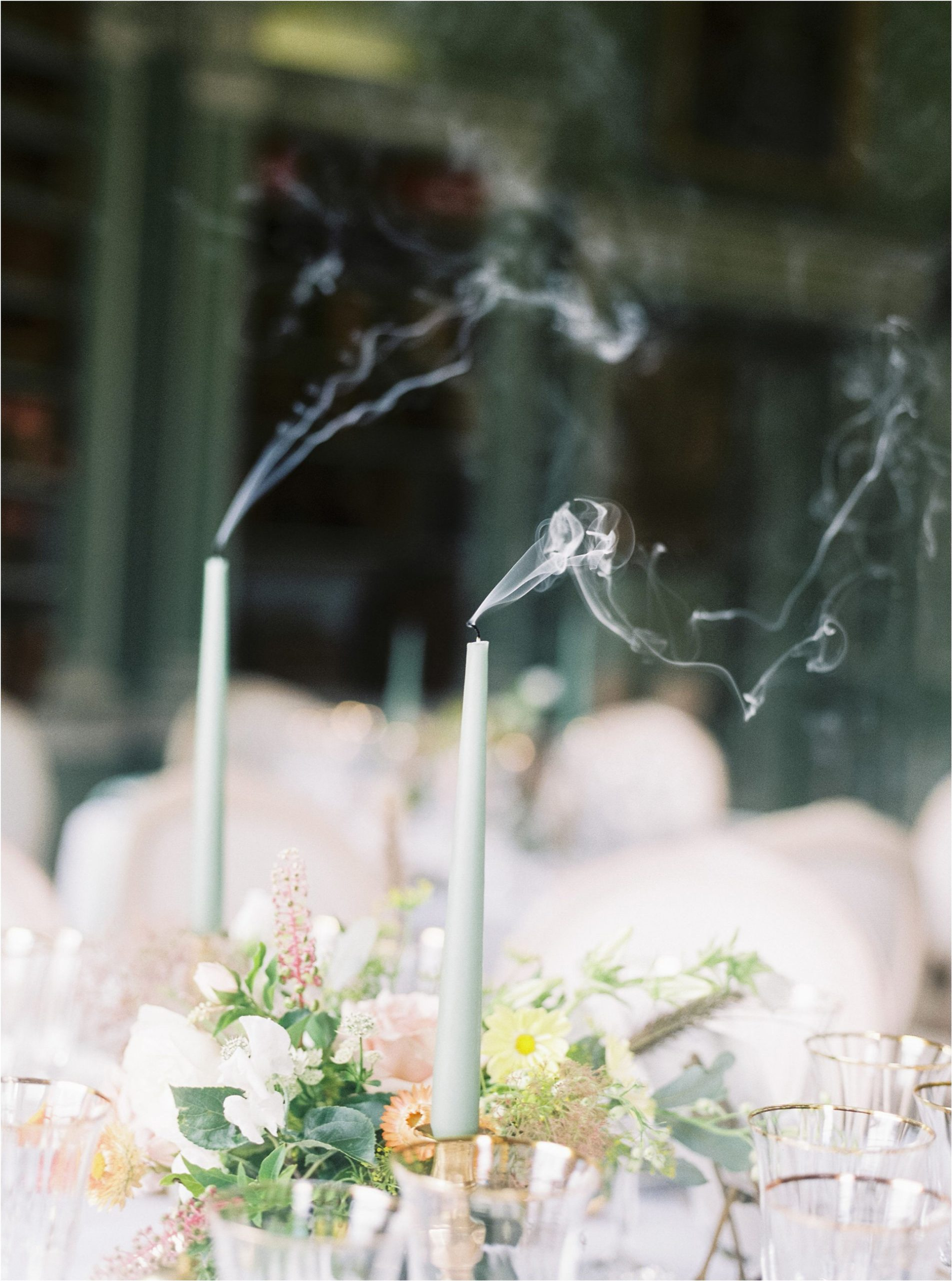 smoking candles on wedding breakfast table
