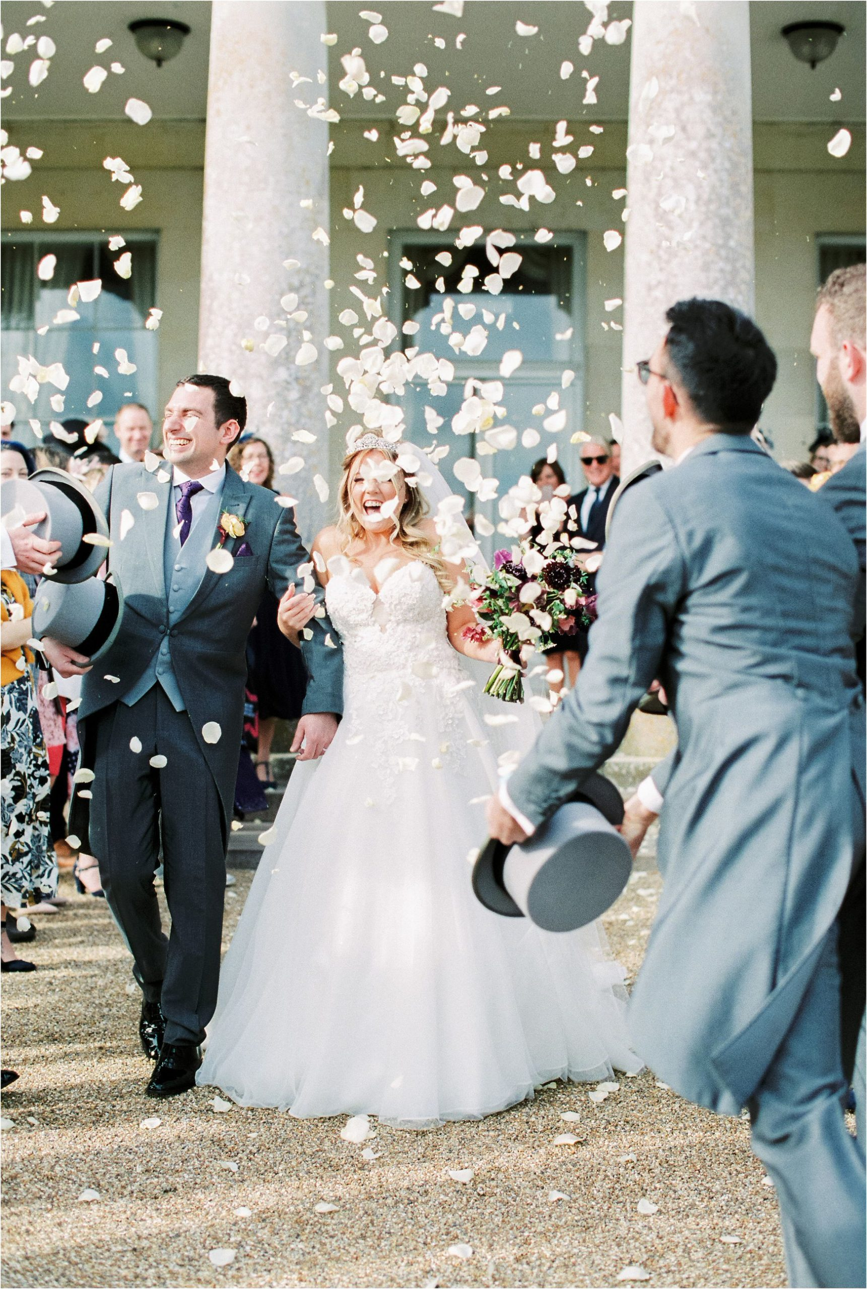 Bride and groom and confetti at Goodwood House