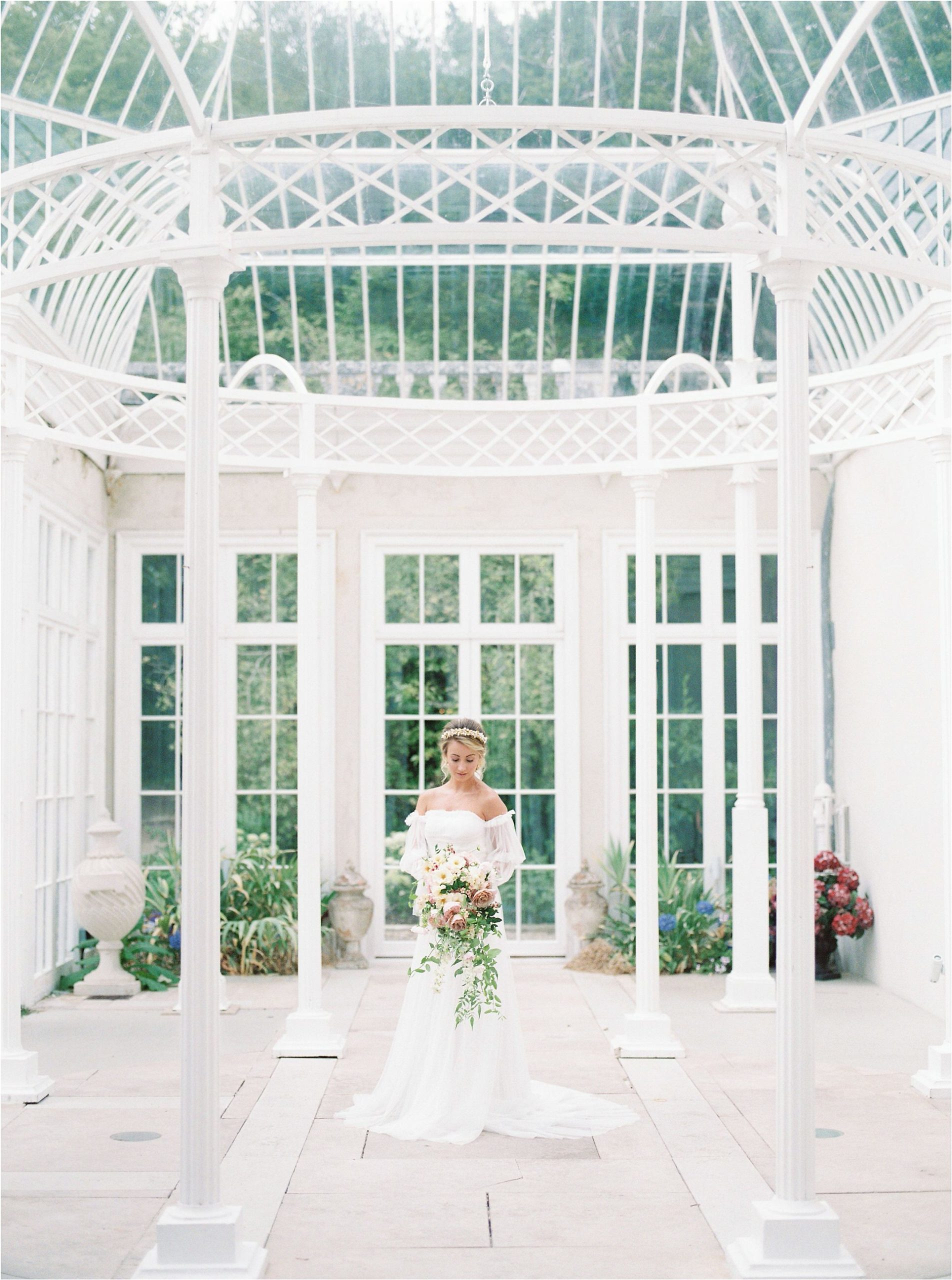 bride in conservatory by UK film wedding photographer