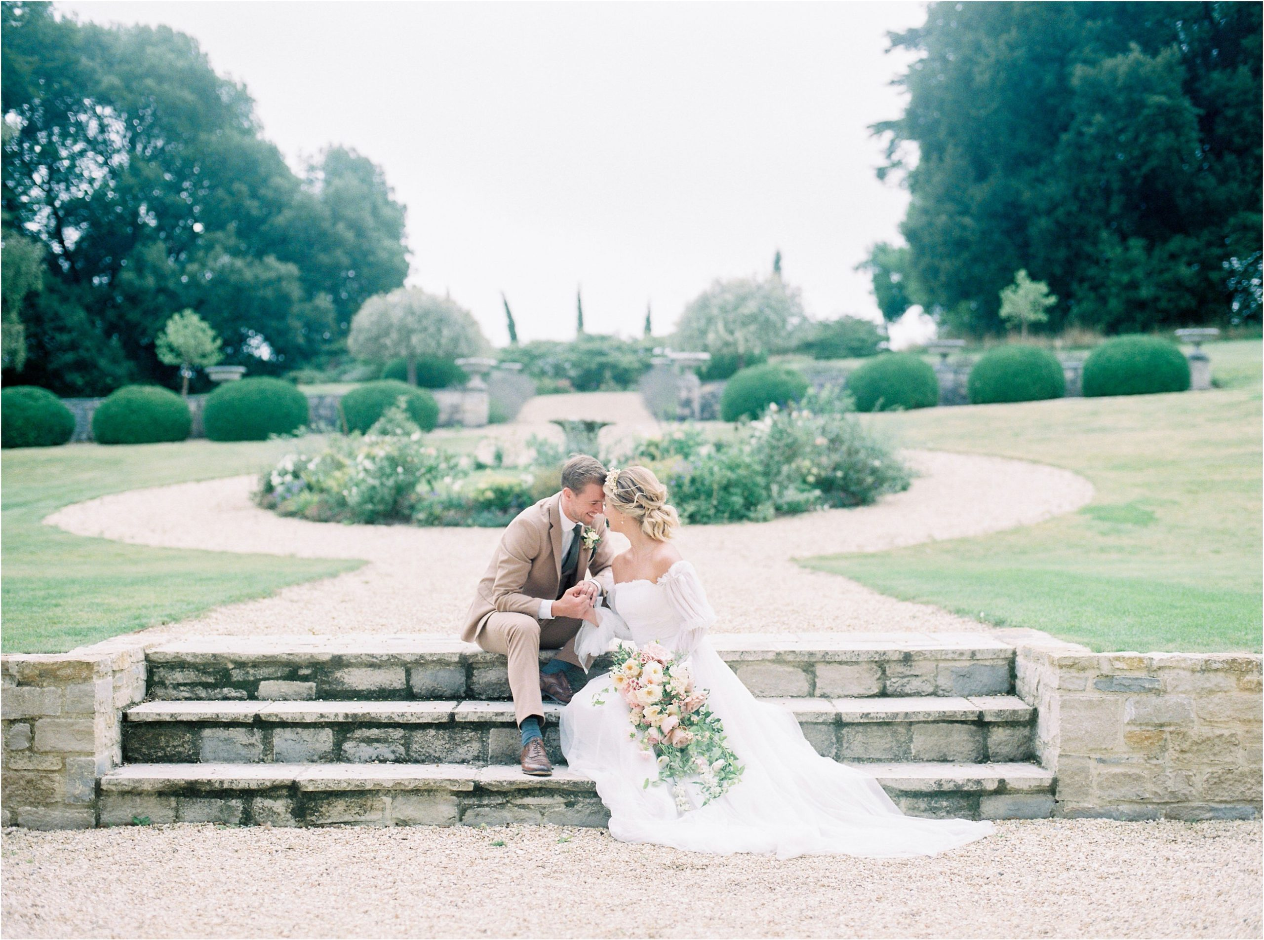 Couple sitting on stone steps at Came House Wedding