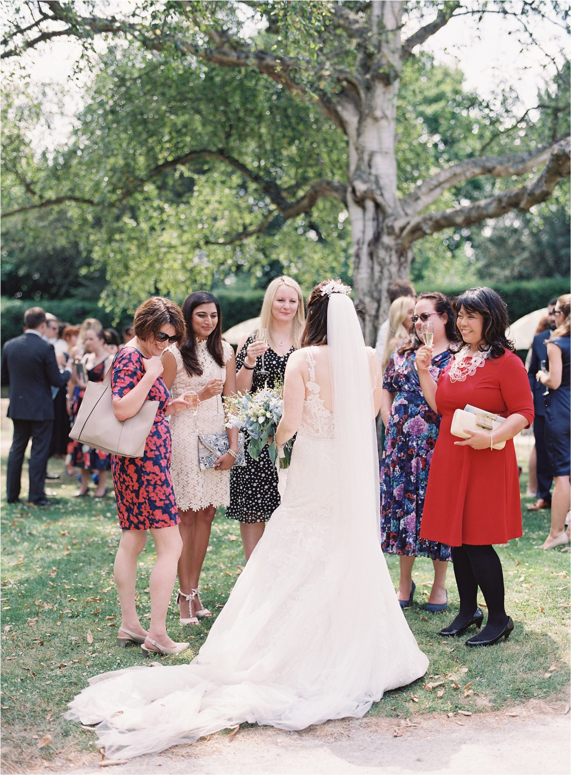 bride talking to guests at Chiddingstone Castle wedding
