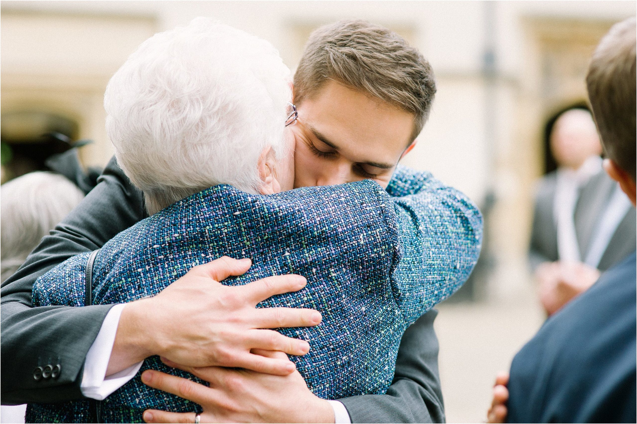 groom hugging grandmother